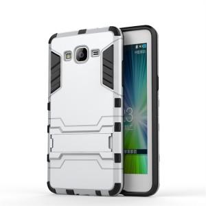 Противоударный двухкомпонентный силиконовый матовый непрозрачный чехол с поликарбонатными вставками экстрим защиты с встроенной ножкой-подставкой для Samsung Galaxy Grand Prime Белый