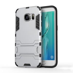 Противоударный двухкомпонентный силиконовый матовый непрозрачный чехол с поликарбонатными вставками экстрим защиты с встроенной ножкой-подставкой для Samsung Galaxy S7 Edge Белый