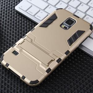Противоударный двухкомпонентный силиконовый матовый непрозрачный чехол с поликарбонатными вставками экстрим защиты с встроенной ножкой-подставкой для Samsung Galaxy S5 (Duos) Бежевый