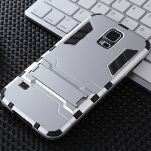 Противоударный двухкомпонентный силиконовый матовый непрозрачный чехол с поликарбонатными вставками экстрим защиты с встроенной ножкой-подставкой для Samsung Galaxy S5 (Duos) Белый