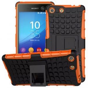 Противоударный двухкомпонентный силиконовый матовый непрозрачный чехол с поликарбонатными вставками экстрим защиты с встроенной ножкой-подставкой для Sony Xperia M5 Оранжевый
