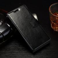 Глянцевый чехол портмоне подставка на силиконовой основе на магнитной защелке для Sony Xperia E5  Черный
