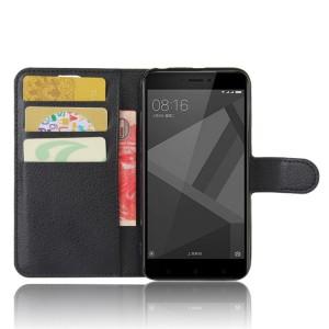 Чехол портмоне подставка на силиконовой основе с отсеком для карт на магнитной защелке для Xiaomi RedMi 4X Черный