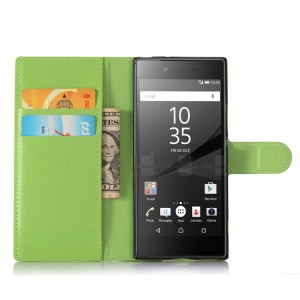 Чехол портмоне подставка на силиконовой основе с отсеком для карт на магнитной защелке для Sony Xperia XA1 Зеленый