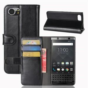 Глянцевый чехол портмоне подставка на силиконовой основе на магнитной защелке для BlackBerry KEYone Черный