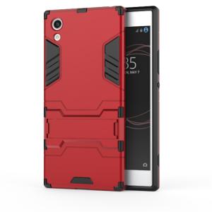 Противоударный двухкомпонентный силиконовый матовый непрозрачный чехол с поликарбонатными вставками экстрим защиты с встроенной ножкой-подставкой для Sony Xperia XA1  Красный