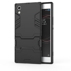 Противоударный двухкомпонентный силиконовый матовый непрозрачный чехол с поликарбонатными вставками экстрим защиты с встроенной ножкой-подставкой для Sony Xperia XA1  Черный