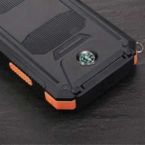 Портативное зарядное устройство 10000mAh в противоударном пылевлагозащищенном корпусе c солнечной батареей, LED-фонариком, 2 разъемами USB (1А+2.1А), встроенным компасом, петлей для карабина и индикатором заряда Оранжевый
